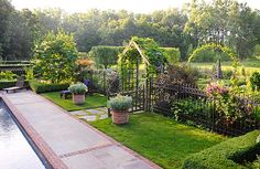 """""""The use of arbors both peaked and rounded adds interest to the landscape."""""""