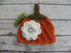 Girl pumpkin hat with white flower and by TrebleStitchBoutique, $20.00