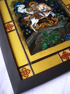 Reverse painting on glass icon depicting 'SAINT GEORGE slaying the Dragon'