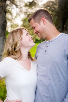 Outdoor, country styled engagement photo by pine trees near Audubon, MN | Amber Langerud Photography