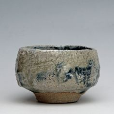 Alan Birchall. Pinched & carved. Apple ash glaze over white slip & blue pigment. Wood-fired.