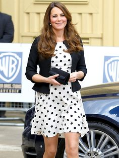 HIT THE SPOT    During a fun-filled visit to England's Warner Bros. studios on April 26, the expectant royal wears an affordable find from Topshop (an $80 black-and-white dress that's already sold out!) with a cropped black blazer and her fave pointy-toe heels.