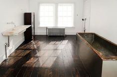 Floating marble sink 18th century & zinc + wood tub 19th century  | Remodelista