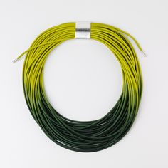 Ombre curved necklace by Gilly Langton http://www.craftscotland.org/profile/352/gilly-langton-jewellery/
