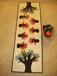 Table runner with all of our kids hand prints as the turkeys!! fall toddler crafts - Google Search