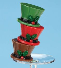 Chocolate Christmas hats from @Wilton Cake Decorating Cake Decorating make a cute holiday treat! #wiltoncookieelf