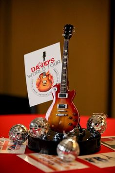 Event Planner Kim Albers pulled out all the stops for future rockstar David when she designed this Rock and Roll themed bar mitzvah celebration. Kim used miniature replicas of some of David's…