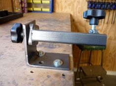 Knife Vise by Tharwa Valley Forge -- Homemade knife vise fabricated from angle iron, steel tubing, MDF, and hardware. http://www.homemadetools.net/homemade-knife-vise-6