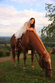 Bride on horse... becuase for a country girl a wedding isn't complete without her horse