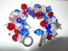 Handmade July 4th Charm Bracelet: Chunky Cluster Bracelet with Red, Clear and Blue Glass Beads and Star Charms by RoyalStreetBoutique on Etsy