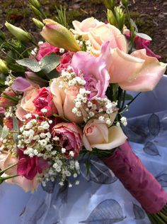 Sweet Avalanche roses & Gypsophila are included in this bouquet