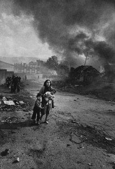 by Don McCullin Palestinian mother and children fleeing Christian gunmen. Karantina, Beirut, Lebanon. Jan. 18, 1976.