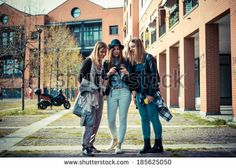 three beautiful friends authentic in urban contest - stock photo BUY IT FROM $1 ON SHUTTERSTOCK
