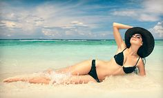 Groupon - Month of Unlimited UV Tanning, One Teeth-Whitening Treatment, and Two or Five Spray Tans at Exotic Tans (Up to 69% Off) in Multiple Locations. Groupon deal price: $49.00