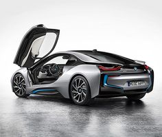 BMW i8 Hybrid.  BMW's latest is a hybrid coupe that marries a 362 hp turbocharged gas engine with a little electric motor to produce impressive 94mpg efficiency plus the ability to roost from 0-62 in 4.4 seconds. The i8 also features exotic 'swan wing' doors and 'electric' blue trim details so there will be no mistaking this thing for a merely sensible car.
