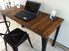 Quick ship item. Modern industrial desk featuring reclaimed American Chestnut with steel legs.