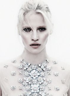 Dutch beauty Lara Stone wears Christopher Kane jewel top from the Spring/Summer 2012 collection in the coverstory for Vogue N...