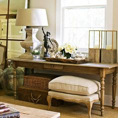 I really like how they used this French inspired farm table in the livingroom/study area instead of just using a smaller end table.  This is much more functional and visibly interesting (to me).