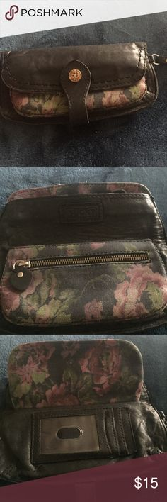 Lucky Brand leather clutch Cute well loved wristlet:clutch. Black leather with floral print details. Magnetic snap closure. Clean with no stains. Weathered look is part of style. Smoke and pet free home. Lucky Brand Bags Clutches & Wristlets