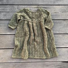 Ravelry: Holly Dress pattern by Pernille Larsen Baby Sweater Knitting Pattern, Lace Knitting Patterns, Knitting For Kids, Baby Knitting, Knitting Ideas, Knitted Baby Clothes, Bobble Stitch, Finger Weights, Christmas Knitting