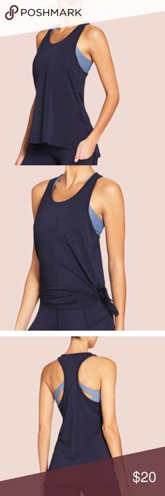 Vie Active Erica Tank - Ink Blue Vie Active Erica Tank - Ink Blue, size M:                       racerback in high-performance, softly draping drirelease® fabric loose or tie it up on the side for a fitted look that will keep you covered during burpees and beyond.   • Performance drirelease® jersey, for superior moisture-wicking, quick-drying, odor-control, and comfort. • High side slits to tie into a crop tank • All workouts, brunch with the girls, tie it up and wear it out on the town. Vie…