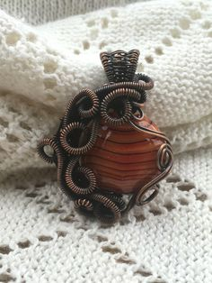 "A personal favourite from my Etsy shop <a href=""https://www.etsy.com/uk/listing/456585236/pendant-glass-lampwork-bead-wrapped-in"" rel=""nofollow"" target=""_blank"">www.etsy.com/...</a>"