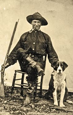 Posed with his faithful canine in this circa 1865-70 tintype, this rustic, pipe-smoking hunter conspicuously exhibits his half-stocked percussion sporting rifle—finished with rather unusual checkering at wrist and extended, handhold trigger guard strap.  – Courtesy Dickinson Research Center, National Cowboy & Western Heritage Museum, 2003.268 –
