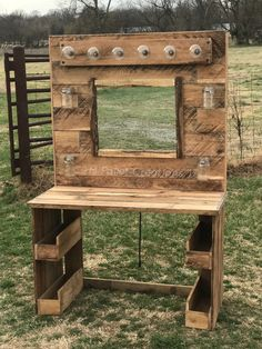 We made this Pallet Makeup Vanity using about 4 pallets. It is lit with a bank of bright lights, has rustic Mason jar storage and more storage underneath.