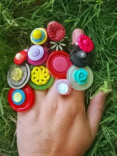 Button Rings! So simple! All you need is buttons and elastic cord. The only problem is keeping people from making to many!