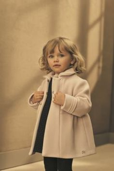 Light pink smooth velvet coat embellished with a TC icon in Swarovski strass #FW15 #fall #winter # campaign #kidsfashion #pink #velvet #coat #swarovski