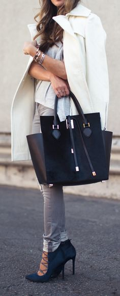 Anyone know who makes this bag? its a pin from revolve clothing.com