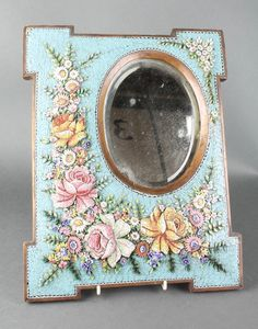 """Lot 264, A Victorian oval bevelled plate wall mirror contained in a micro mosaic Oxford shaped frame 15"""" x 11 1/2"""", Est £80-120"""