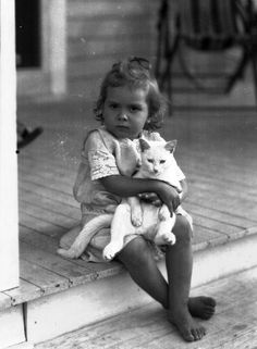 """fewthistle:  """"Don't Even Think About It."""" Small girl and her cat. Florida. 1920s. Photographer: Unknown"""