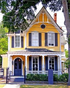 yellow Victorian farmhouse  -- found on http://holypeaches.tumblr.com/post/10109453435
