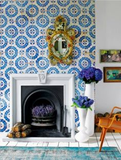 Love the texture and colors of this Moroccan tile offset with that gilded Rococo mirror...