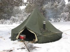 """bjornnormann: """"This is a M1950 army tent with a wood stove hook up. From what I've read, many of these are still in use after 50 to 60 years. I want one."""" - From Pinterest."""