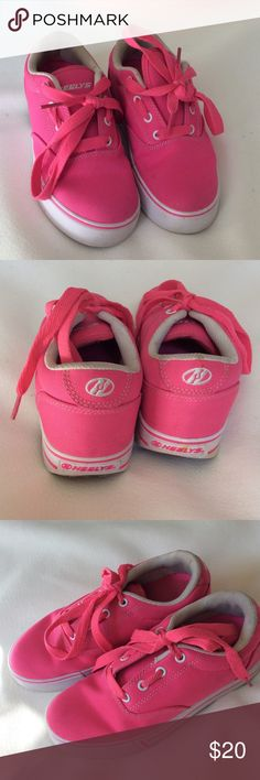 Hot Pink Heely's Great condition. A little discoloration on the white part of the shoe. Pink looks new. Key not included. Tennis roller skates!! Great for Xmas!! Heely's Shoes Sneakers
