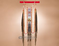This Authentic Pueblo Warrior Breast Plate can be hung on a wall to bring the Native American culture to life in your home.