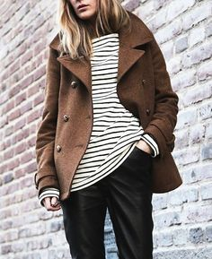 A classic brown wool peacoat with preppy black and white striped cotton shirt paired with sleek black pants - gorgeous.