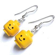 Well that's creepy! Here! I'm wearing yellow heads as ear decor!!!!<<< Are you serious? Those are lego heads! That's awesome!