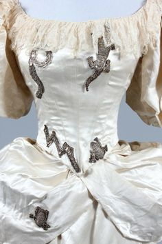 Antique 19th century 'White Witch' costume, 1880s, with silver sequined owl, bat, lizard, snake and lighting bolt motifs.