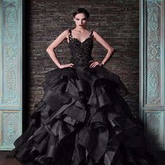If you're looking for dramatic yet stunningly elegant, this is the dress. It all starts with a gorgeous thick lace bodice with scoop neckline and lace straps and then flows into layers and layers of thick, gorgeous, patterned taffeta. The dress has a court train, but can be customized to your preference. If you're looking to make an entrance that will be remembered forever, this is the dress to do it in. Dress is lovingly handmade to order and takes approximately 4-6 weeks to complete. Rush…