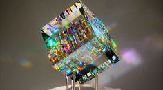 """Since 2004, California-based artist Jack Storms has been producing these rare """"optic sculptures."""" Created by precision-machining lead crystal and dichroic glass, a single piece can take up to 18 weeks to produce."""