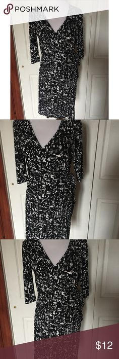 "Apt 9 Black and White Faux Wrap Dress - XS Pretty, figure flattering faux wrap style dress by Apt. 9. Half sleeve style. No material or care tag, but it feels like a stretchy polyester/spandex to me. I'd also hand wash to be safe or use same care that's suggested for a similar dress/fabric you may already have. Size extra small. Measures 16"" shoulder to shoulder, 18.5"" armpit to armpit, 14"" across waist, 18"" across hips, 35"" long and 15"" long sleeves.   Proceeds go to the spay/neuter/care of…"