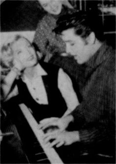 Elvis playing piano at the house of Lizabeth Scott  with at his side Dolores Hart  winter 1957
