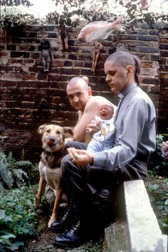 Genesis P.Orrige with David Tibet and his daughter Caresse in London, Hackney (1982) by photographer Ilse Ruppert. ~Look at this! A fish, dolls, punks, a crying baby and a dog to top it all off!