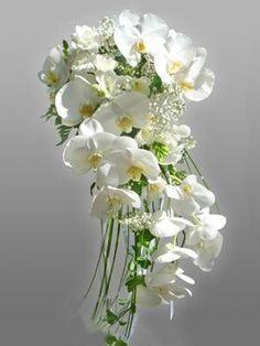 brides boquet. perhaps a little simpler with more babys breath to tie in with bridesmaids