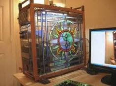 Just listed as a custom PC Case made of stained glass and copper, look at those trays. There's something more to this case.