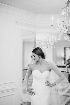 black and white shot of a bride just after she finished getting ready on her wedding day // atlanta wedding photographer, youareraven, black and white, christ the king, cathedral, atlanta church