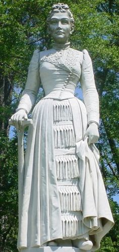 Laura Van Mitchell Kelly: This monument to a beloved housewife and mother towers over all others in the Kosciusko City Cemetery. Mr. Kelly so loved his dear departed wife that he had this nearly 20 ft. tall monument erected so that he could view her from his home several blocks away.